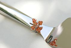 Fall wedding cake server and knife in one with removable handmade Swarovski crystal charm.  Choose your colors and have it engraved too www.beadz2pleaz.com or www.beadz2pleaz.etsy.com