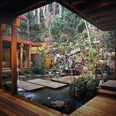 Amazing water feature for the ultimate zen backyard oasis.  I love how this house wraps around the pond.