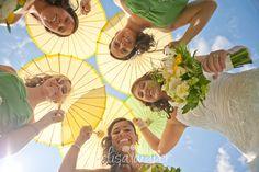 Fun bridesmaids with umbrellas