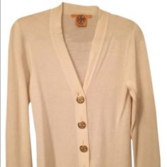 "Tory Burch Simone Cardigan Classic Ivory Tory Burch ""Simone"" cardigan with gold TORY logo buttons. From TB: ""A wear-with-all layer for work, weekends and everything in between, our Simone Cardigan is a style staple no matter the season. Made of superfine merino wool and punctuated with signature metallic buttons, this versatile piece works with everything."" Tory Burch Sweaters Cardigans"