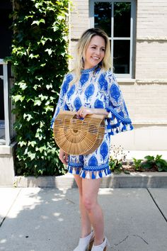 the perfect summer outfit and the tassels are to die for. I paired it with the most adorableIT bagof the season and I found one for under $80!