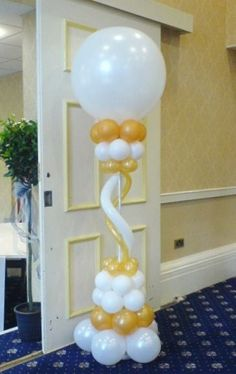 Classic balloon column in gold and white.