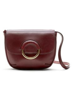 Loving our 100% Italian leather saddle bag with circle metal detail. This burgundy bag is the perfect little purse for your weekend adventures and nights out on the town | Banana Republic
