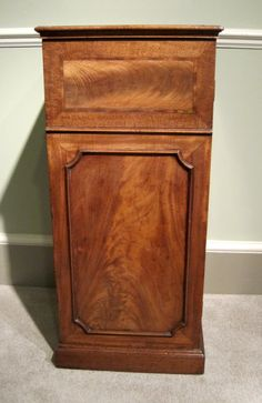 A fine Georgian faded mahogany pedestal cupboard, with cross-banded and astragal panelled door, enclosing one shelf. Original brass catch. Circa 1800.