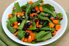 Cleanse and Detox Superfood Salad - 5 cups baby spinach; 1 cup fresh blueberries; 2 carrots, thinly sliced; 12 raw almonds, sliced; 2 dates (pitted and diced); 2 tablespoons extra-virgin olive oil; 1 tablespoon freshly squeezed lemon juice