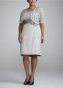 Chic and classy, this lace dress is perfect for any Mother of the Bride!   Sleeveless dress features ultra feminine and unique pretzel lace detail.  Empire waist creates a flattering silhouette.  Ruched band and 3D flower detail finish off the look.  3/4 sleeve jacket offers just the right amount of coverage.  Fully lined. Back zip. Imported polyester. Dry clean.Also available in missy sizes as Style 1121.