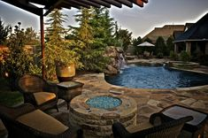 Pools with waterfalls and fire pits glass fire pit and flagstone walkway in Backyard Ideas For Small Yards, Small Backyard Pools, Fire Pit Backyard, Backyard Landscaping, Patio Ideas, Landscaping Ideas, Pool Ideas, Garden Ideas, Glass Fire Pit