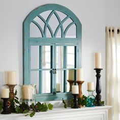 We're fans of a mirror with character. Particularly one with an antiqued turquoise finish. Carefully placed, this mirror will create an illusion of surprise passageways with its casement framing topped by a faux fan transom. Living Room Windows, My Living Room, Living Room Decor, Home Decor Styles, Home Decor Accessories, Diy Home Decor, Faux Window, Window Mirror, Arch Mirror