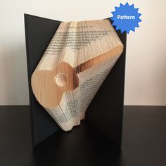 This listing is for a book folding pattern which will enable you to create your own finished book. This pattern: Guitar – 168 folds (336 pages) - 21cm book (minimum) Your pattern will automatically download as a pdf on receipt of payment. You will also receive comprehensive instructions with easy to follow pictures. These will take you through every step of how to fold a book. The instructions will show you how to calculate the number of pages you need in your book in order to complete a…