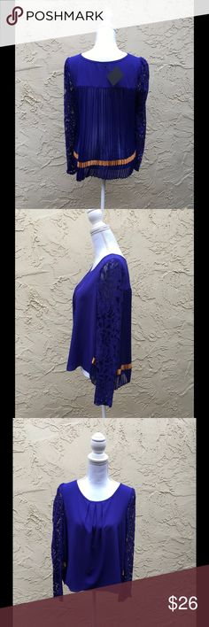 "Blue Cobalt Chic Blouse Crochet Sleeves, By Ryu Stunning Blouse By Ryu Boutique, Pleated Back Blue Cobalt with Orange Stain around The Back Hem, Crochet Sleeves,Large Size Measures 20"" armpit to armpit and 23"" length. Ryu Tops Blouses"