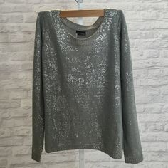 Sparkly Urban Outfitters sweater Gray sweater with silver paint on it. Really warm and soft. No signs of wear. Urban Outfitters Sweaters Crew & Scoop Necks
