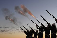 """Members of the Albert Battery shoot a volley of fire during the Anzac Day dawn service on the Gold Coast in Currumbin, Queensland, on the centenary of the Gallipoli landings in the first world war. <a href=""""http://www.theguardian.com/artanddesign/ng-interactive/2015/apr/24/allies-campaign-in-gallipoli-1915-and-now-interactive"""">View then and now photography of the landings here</a>"""