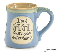 """#burtonandburton Dishwasher safe/FDA approved/Microwave safe.<br>Porcelain hand-painted light blue mug with taupe rim and """"I'm a Gigi. What's Your Superpower?"""" message.  Individually gift boxed. <br><br>4 3/4"""" H x 3"""" Opening.  Holds 18 oz. <br>1 set of 4."""
