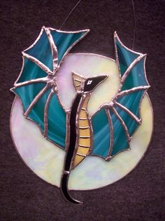 Items similar to Dragon and Moon Stained-glass hang on Etsy Stained Glass Ornaments, Making Stained Glass, Custom Stained Glass, Stained Glass Birds, Stained Glass Suncatchers, Stained Glass Panels, Stained Glass Projects, Stained Glass Patterns, Fused Glass