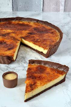 Creme Brulee Tart - Chocolate pastry, filled with sweet custard and topped with a caramel layer.