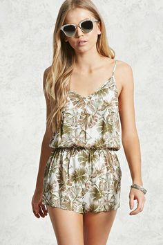 Style Deals - A woven romper featuring an allover palm tree leaf print, a V-neck, adjustable cami straps, and an elasticized waist.