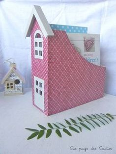 """How great would a """"village""""of these look on your bookshelf. Altered magazine holder"""
