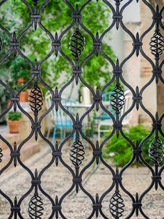 Photo about Detail of wrought iron gate. Courtyard of Cordoba, Spain. Image of city, aged, detail - 55178003