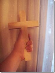 """Give each child a wooden cross to carry around with them wherever they go.  At times it will be hard or bothersome. It may get worn, dented, scratched or colored on. When they have to do something unpleasant, they take their """"cross"""" with them and offer it up.  At Easter, talk about the crosses. Then grab bright paints & paint the crosses to look bright and new as Jesus' body on Easter morning when he rose from the dead. Then attach hooks near the bottom so we can use these as rosary hangers."""