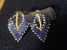 I made... Russian leaf earrings purple/blue delicas size 11, pale yellow seed beads size 11
