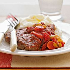 Swiss Steak-I altered this: used cube steak and canned diced tomatoes and added my own basil and oregano. Swapped green onion for regular onion. And I cooked on high in slow cooker for 3.5-4 hours.