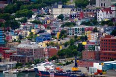 Pin for Later: 19 Unreal Places in Canada You Must See Before You Die Jelly Bean Row, St. John's, Newfoundland and Labrador The downtown area of St. John's is filled with colorful houses totally worthy of a picture. Places Around The World, Oh The Places You'll Go, Places To Travel, Places To Visit, Around The Worlds, Newfoundland Canada, Newfoundland And Labrador, Ottawa, Cinque Terre