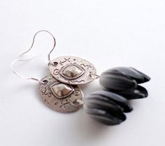 For more classy look! Black and white flower tulip earrings with silver oval by Rotdaris, $12.00