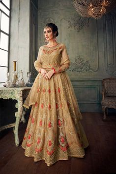 Glamorous look in ethnic style with fashionista party wear beige anarkali long gown. Top : Heavy Net with Satin Silk Inner Border : Fully embroidered. Inner and Bottom : Banglori Santoon. Designer Salwar Kameez, Designer Anarkali, Anarkali Tops, Anarkali Lehenga, Long Anarkali, Anarkali Suits, Lehenga Suit, Indian Anarkali, Lehenga Choli Designs