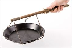 This antique kitchen utensil was used to lift pie plates from the hearth