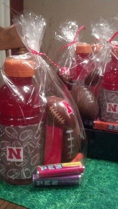 Football party favors.  Now to find the football Pez. Could put a bible verse inside to give to players!!!