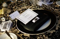 Bold black and white table settings. Photo via Project Wedding