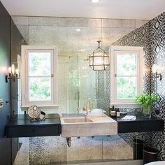 White And Black Bathroom With Antiqued Mirrored Accent Wall