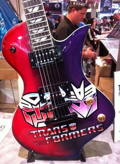 Transformers guitar. I WANT THIS GUITAR SOO BAD!!!!! <3