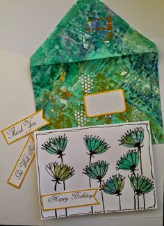 Too many hobbies!  Painted delipaper envelope with leftover paper bits and scribbes to make card with optional sentiments run through sticker machine