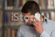 Male Student Talking On The Phone In Library royalty-free stock photo