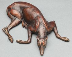 Louise Peterson - latout, bronze I was working on a portrait of Becka, a retired racing Greyhound, and she kept gravitating to this pose.