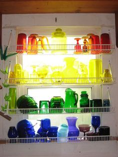 Glass Display...not fond of the shelf choice but love the idea of colored glass in a window