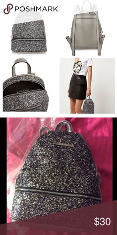 River Island Backpack Never used. Have too many bags. Height is 9.5 inches. Beautiful and glittery! River Island Bags Backpacks