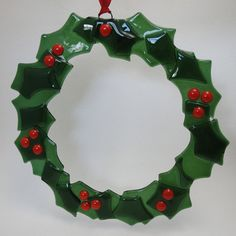 Holly Christmas Wreath Fused Glass- I would love to make out repurposed water bottles .