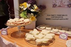 Tea party sandwiches were fun and easy to make. Josephine served ham and cheese butterflies, cucumber and cream cheese butterfly sandwiches, and heart shaped peanut butter and jelly sandwiches. Country Graphics Tea Party Printables include table food tents.