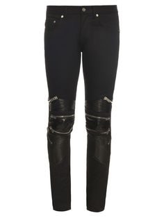 Saint Laurent's black stretch-skinny jeans are a uniquely cool take on a classic biker style. They have a traditional five-pocket design and feature heavy-duty lamb-leather knee guards with slick silver-tone zips and ribbed panels.