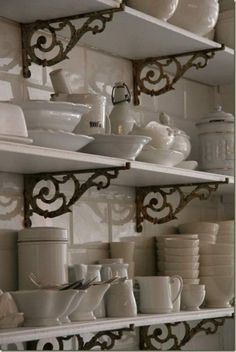 Love the shelf brackets and the white dishes