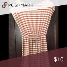 Striped dress; 61% polyester 33% rayon 6% spandex Orange and cream striped t-shirt dress Soprano Dresses