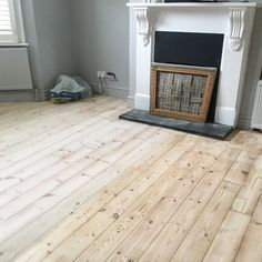 Pine Wooden Floorboards Half Treated With Finneyu0027s White Wood Dye (diluted  On A Ratio) In A London Victorian Terrace Living Room