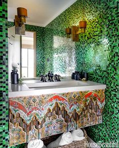 I suppose if you're pushing for color, you should really go for it. The black and green wall mosaic tile is a little busy for me, but I'm in absolute awe of the 1920s Turkish relief panel. It's like artwork for your vanity!