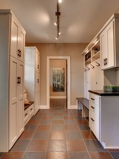 Off Garage:  mudroom, laundry room, bath room, and access to pantry