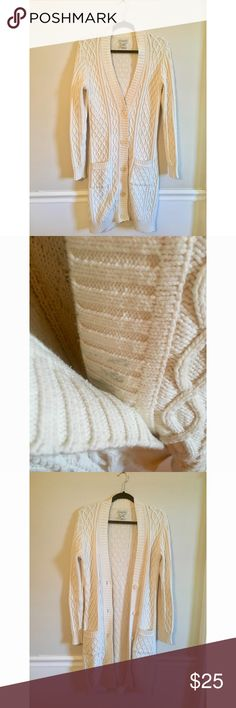 Banana Republic Beige Cream Cable Knit Cardigan Banana Republic Beige Long Cable Knit Cardigan adds amazing texture to cardigans and tees.  Stain photographed, unable to see it when buttoned up.  Missing belt, otherwise excellent Condition.  Additional pics included for styling inspiration Banana Republic Sweaters