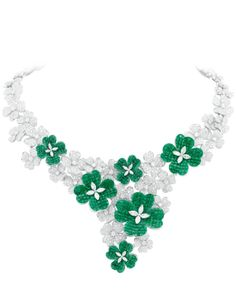 An emerald and diamond garden grows in winter.  Van Cleef & Arpels Jewelry - Town & Country Magazine