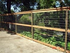 3 rail wire fence. I like the 3 rails, with the cap at the top. Between parking and side yard. Just for the side facing the street. Other side is solid wood with 3 rails.