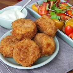 Fish cakes and tomato salad